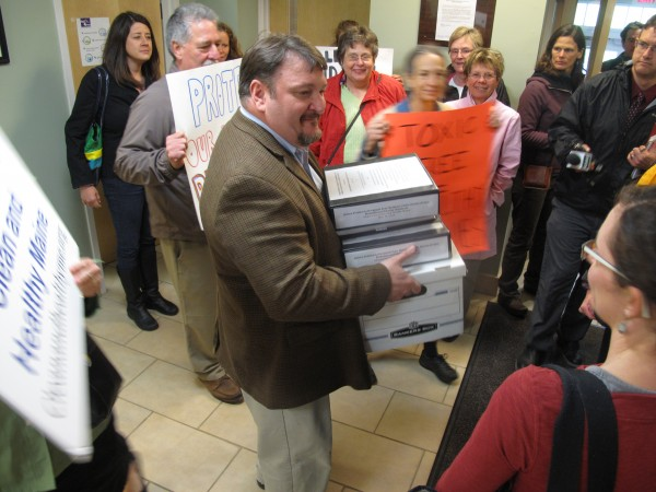 Mike Karagiannes, rule-making liaison for the Maine Department of Environmental Protection, receives a petition with more than 2,000 signatures urging the agency to regulate phthalates, potentially dangerous chemicals found in many household products.