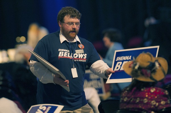 Grady Burns hands out posters supporting Shenna Bellows for U.S. Senate at the Maine Democratic Convention at the Cross Insurance Center in Bangor, Maine, Saturday, May 31, 2014.
