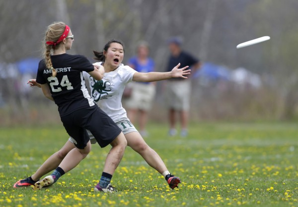 Jamie Hong (left) of the Stuyvesant High School Sticky Fingers, from New York City, attempts to block a pass from Elende Connor of the Amherst, Massachusetts, Hurricanes on Saturday in South Portland.
