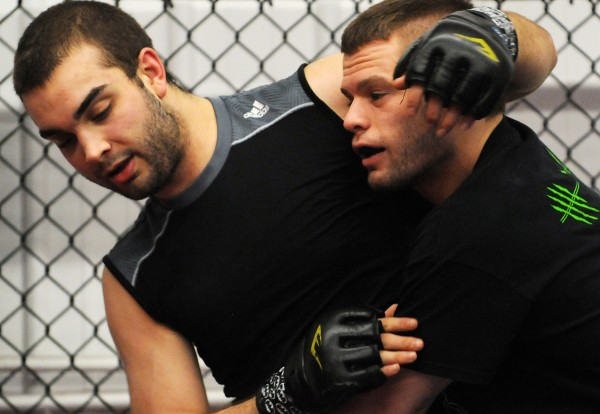 Mixed martial arts fighter Ryan Sanders (right) trains with Nash Roy at Young's MMA in Bangor on March 13.