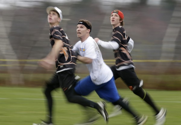 Falmouth's Andre Clement (center) is double-teamed by two Pennsbury High School players as he prepares to attempt a catch on Saturday in South Portland.