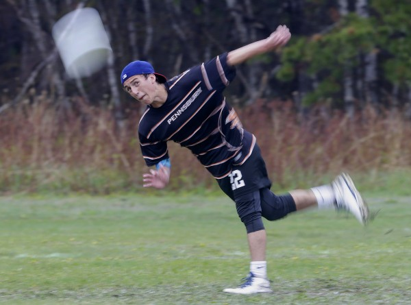 A player from Pennsbury High School launches a frisbee to start a game of Ultimate on Saturday in South Portland.