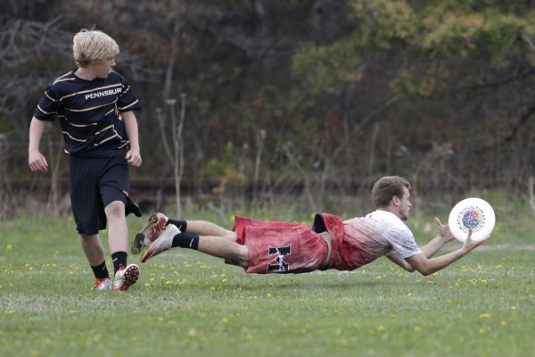 Adam Grammar (right) of Masconomet Regional High School in Topsfield, Massachusetts, lays out to catch the disc while being defended by Pennsbury High School's Mac Rushing on Saturday in South Portland.