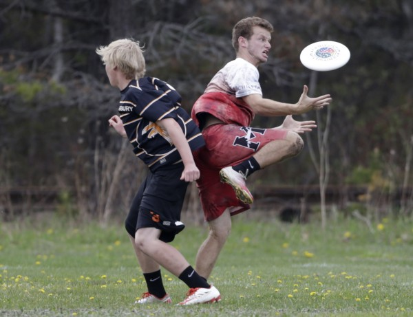 Adam Grammar (right) of Masconomet Regional High School in Topsfield, Massachusetts, reaches for the disc while being defended by Pennsbury High School's Mac Rushing on Saturday in South Portland.