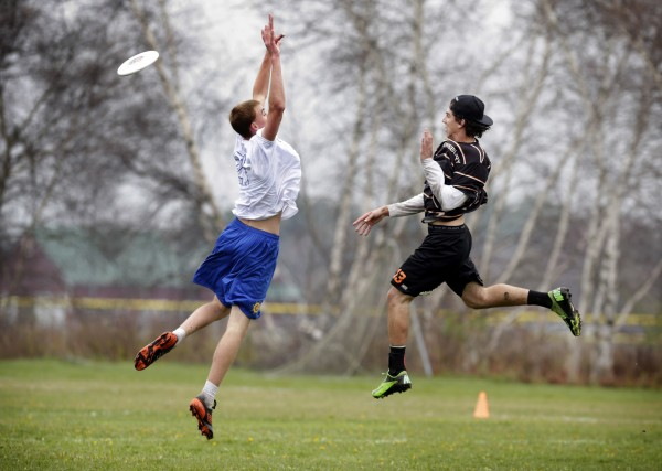Christian Duess (right) of Pennsbury High School in Fairless Hills, Pennsylvania, knocks the disc away on a pass intended for Cole Aaskov of Falmouth High School on Saturday in South Portland.