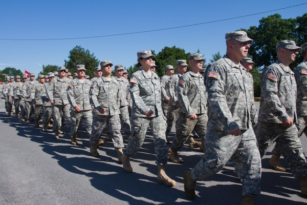 The 133rd Engineer Battalion marched from the University of Southern Maine campus to the Exposition Building as they prepared to leave for Afghanistan in 2013.