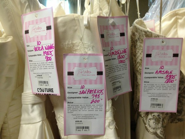Tags hang on wedding dresses at a Brides Against Breast Cancer pop-up bridal boutique event, which is making its way to Bangor June 1.