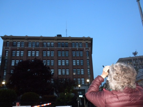 Lucy Quimby, Bangor Land Trust president, uses a pair of binoculars to look for migrating chimney swifts  Sunday, May 25, 2014.