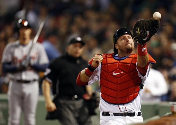 Boston Red Sox catcher A.J. Pierzynski loses control of a pop-up against the Detroit Tigers during the seventh inning at Fenway Park in Boston Sunday night.