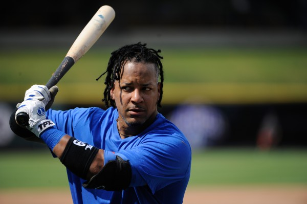 Round Rock Express left fielder Manny Ramirez warms up prior to the first pitch against the Omaha Storm Chasers at the Dell Diamond in Round Rock, Texas, last July.