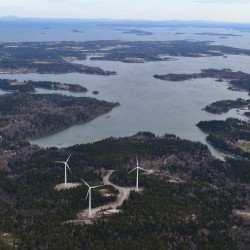Fox Islands wind turbines are shown in 2012. The village of North Haven can be seen in the upper left-hand corner.