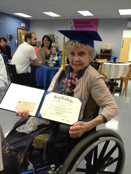 Jessie Jones-White poses with her certificate of completion for her degrees in account bookkeeping and stenography from 1939 (left) and her diploma from Beal College (right), replicating the diploma she would have received 75 years ago if she had the money.