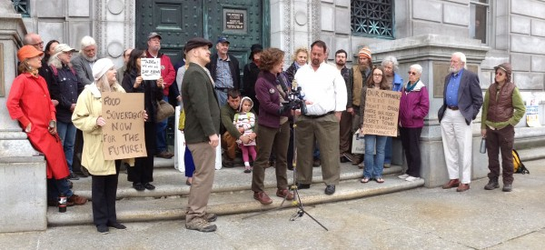 Supporters flank former dairy farmer and raw milk vendor Dan Brown (center, in white shirt) Tuesday at the Maine Supreme Judicial Court.