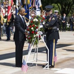 President Barack Obama places a wreath at the Tomb of the Unknown Soldier at Arlington National Cemetery Memorial Day in Virginia May 26, 2014.