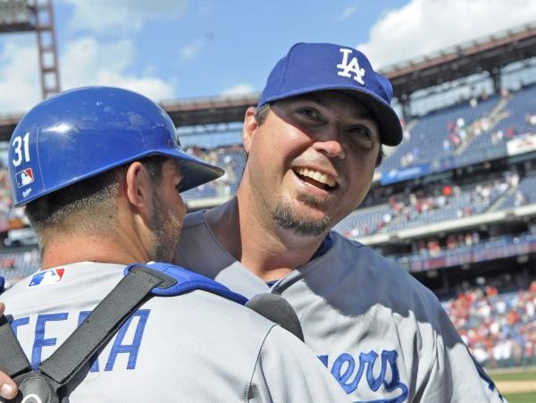 Los Angeles Dodgers starting pitcher Josh Beckett (right) celebrates his no-hitter with catcher Drew Butera after defeating the Philadelphia Phillies at Citizens Bank Park in Philadelphia Sunday. The Dodgers defeated the Phillies, 6-0.
