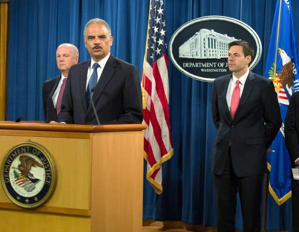 U.S. Attorney General Eric Holder (second left) announces the indictments of five Chinese nationals on cyber espionage charges for allegedly stealing trade secrets from American companies, during a Monday news conference at the Justice Department in Washington.