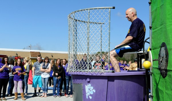 Bucksport High School principal Dan Clifford is ready to be dunked in the dunk tank as a student hits the target during a surprise field day on Friday. The day of events was put together by school staff and parents as a way to bring students together for some fun and laughter after a difficult year.