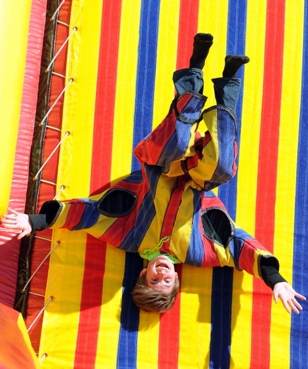Aaron Kircheis, a freshman, sticks himself to a velcro wall during a surprise field day held at Bucksport High School on Friday. The day of events was put together by school staff and parents as a way to bring students together for some fun and laughter after a difficult year.