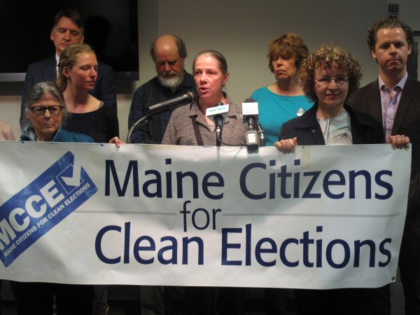 Ann Luther, president of Maine Citizens for Clean Elections, addresses reporters Tuesday at the State House. The group unveiled a new initiative to increase the amount of money available to publicly funded candidates.