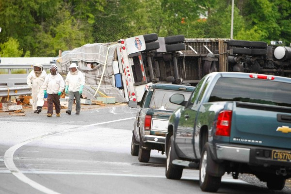The tractor-trailer overturned about 6:10 p.m. Tuesday on the Del. 896 on-ramp to northbound I-95 at the outskirts of Newark, Delaware.