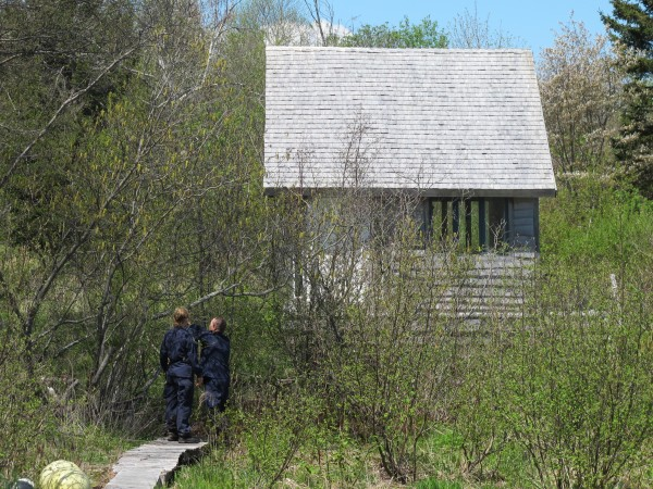 Two Maine State Police troopers look for clues Thursday at a residential property off Clark Street in Eastport while trying to find out what may have become of Marilyn Lehan.