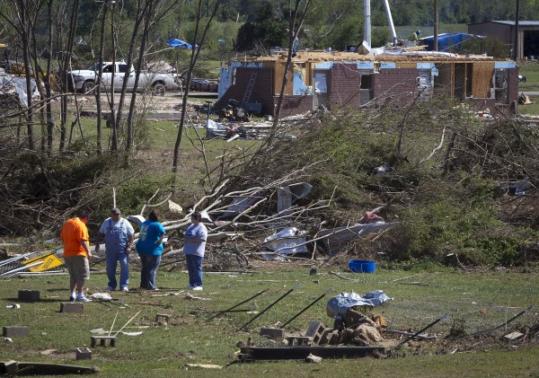 Volunteers pick up debris as the clean up continues in Vilonia, Arkansas on May 1, 2014. The worst floods in decades deluged roads and engulfed homes and cars in Florida's Panhandle and coastal Alabama on Wednesday, the latest mayhem created by a tornado-packing storm system that has killed at least 34 people this week.