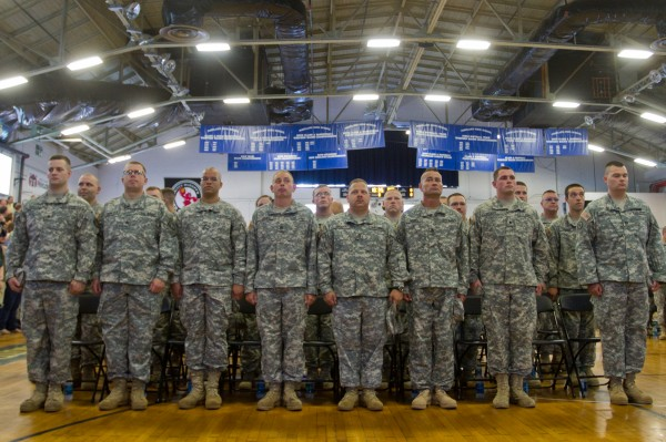 Members of the 133rd Engineer Battalion stand at attention during a Heroes' Send-Off ceremony in the Portland Exposition Building on Aug. 10, 2013.