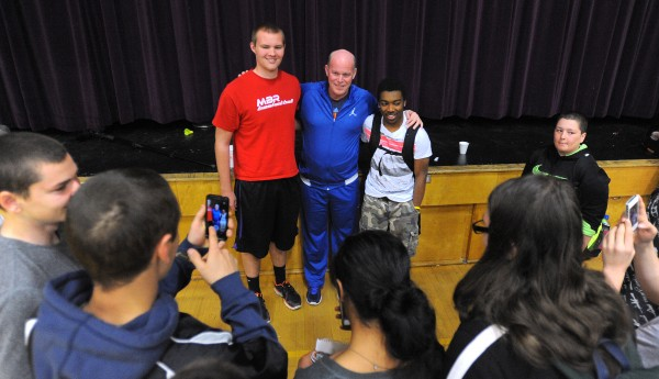 Steve Clifford (center) poses for a picture with Bucksport High School students Riley MacLeod (left) and Josh Gray.  Clifford is the head coach of the NBA's Charlotte Bobcats and a Maine native who spoke with the students at Bucksport High School on Thursday about being successful coming from a small town.