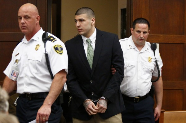 Former NFL player Aaron Hernandez enters the courtroom to be arraigned on homicide charges at Suffolk Superior Court in Boston, Massachusetts, May 28, 2014. Hernandez pleaded not guilty on Wednesday to charges of murdering two men he met in a Boston nightclub in 2012.