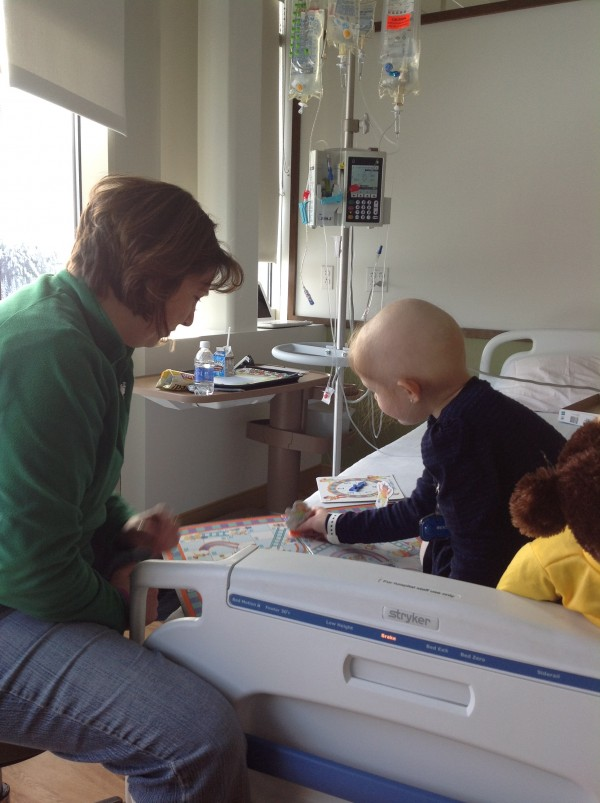 Victoria Grotton and Ellie LaBree play a board game during Grotton's visit while Ellie underwent chemotherapy over Christmas vacation.