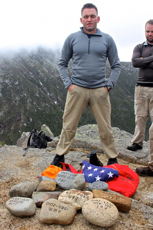 Marine Maj. David Cote, founder of The Summit Project, stands by tribute stones for Maine's fallen heroes atop The Owl in Baxter on Saturday. That day, 35 hikers carried tribute stones up and down the mountain in honor of certain Maine service members who gave their lives in the line of duty.