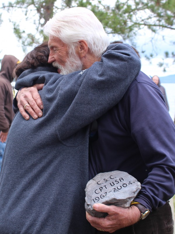 George Pulkkinen, 75, of Scarborough, hugs Nancy Lee Kelley of Old Orchard Beach after carrying a tribute stone for her son, Army Capt. Christopher S. Cash, to the top of The Owl, a mountain in Baxter State Park, on Saturday. Cash was killed in 2004 while serving in Iraq. The 16-pound tribute stone is a part of The Summit Project, a &quotliving memorial&quot to Maine's fallen heroes.