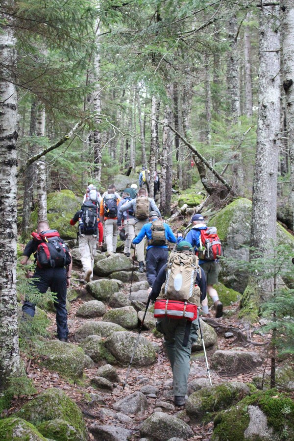 A team of hikers for The Summit Project climb a steep section of a trail leading to the summit of The Owl in Baxter State Park on Saturday in honor of Maine's fallen heroes.