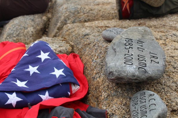 A stone in tribute of Marine 1st Lt. James R. Zimmerman of Smyrna who died in 2010 at Camp Bastion, Afghanistan, of wounds received while conducting combat operations, sits on the summit of The Owl in Baxter State Park on Saturday after being carried there by Marine Major David Cote for The Summit Project.