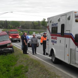 Woman survives crash on Route 1 after going airborne