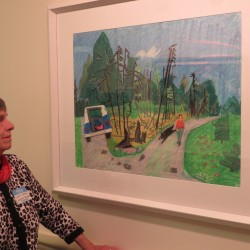 Jane Sumner, daughter of Maine artist Arthur Thompson, looks at one of her father's artworks hanging at the Boyd Place Gallery in Bangor.