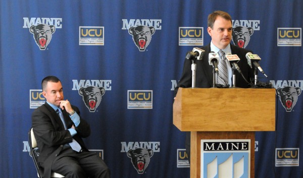 University of Maine athletic director Karlton Creech (right) introduces Bob Walsh, the new men's basketball head coach, during a Friday press conference at the Cross Insurance Center in Bangor.