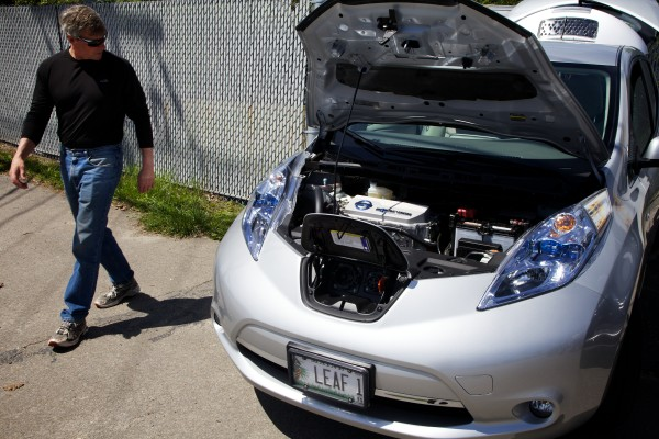 Ron Grahm of North Yarmouth gives a Nissan plug-in electric car a good look at an electric car event in Portland Thursday.