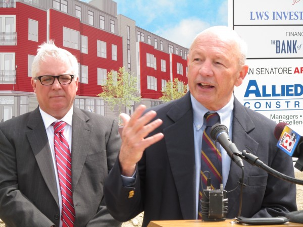 Portland Mayor Michael Brennan (right) discusses the need for more housing in the city during a ceremonial groundbreaking Tuesday for the 39-unit West End Place apartment building in Portland.City Manager Mark Rees stands to his side.