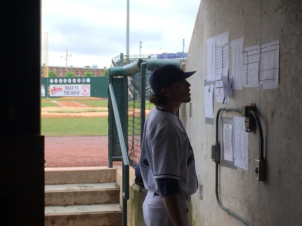 University of Maine pitcher Burk FitzPatrick checks out the game lineups in the dugout prior to Friday's America East baseball tournament game against Binghamton at LeLacheur Park in Lowell, Massachusetts.