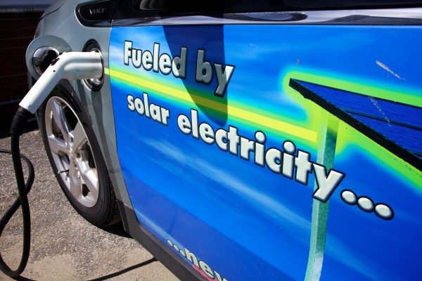 An electric car charges up on solar power at a media event in Portland Thursday.