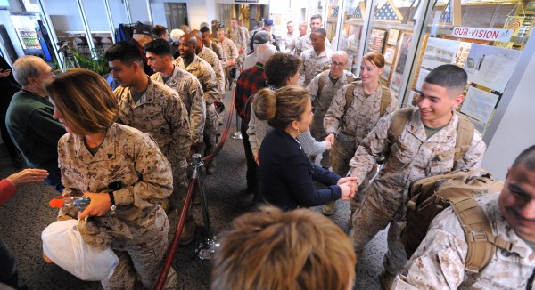In this March 2014 file photo, Maine Troop Greeters shake hands with Marines as they arrive at the Bangor International Airport.