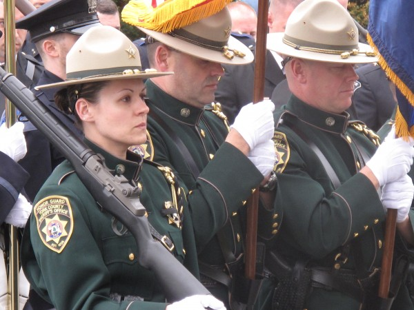 Members of the York County Sheriff's Office honor guard stand silently Thursday as Gov. Paul LePage speaks in honor of the 83 law enforcement officers in Maine's history who lost their lives in the line of duty.