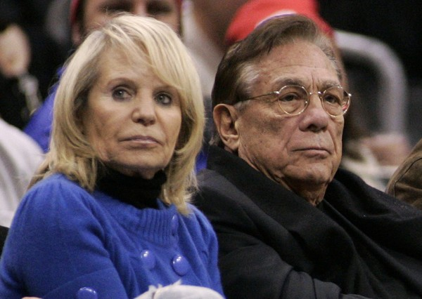Los Angeles Clippers owner Donald Sterling (center), his wife Shelly (left) attend the NBA basketball game between the Toronto Raptors and the Los Angeles Clippers at the Staples Center in Los Angeles, in this December 22, 2008 file photo.