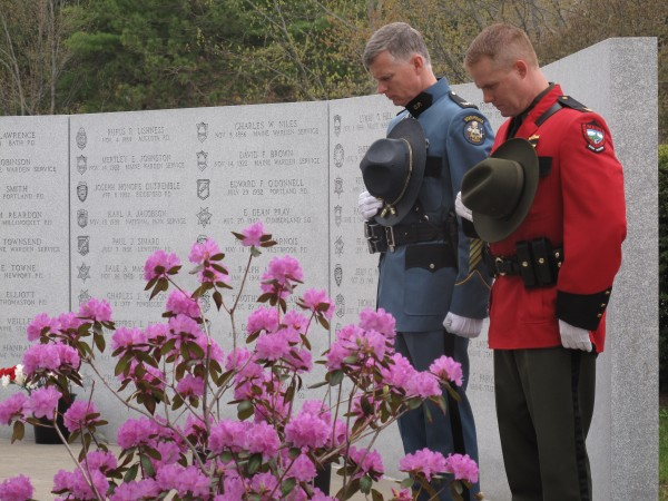 Maine State Police Col. Robert Williams and Maine Warden Service Col. Joel Wilkinson bow their heads during a prayer at Thursday at the Maine Law Enforcement Officers Memorial in Augusta.
