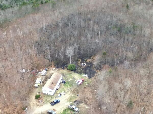 An aerial photo of the 4 acres behind a Ridge Road home that were burned by a forest fire on Friday.