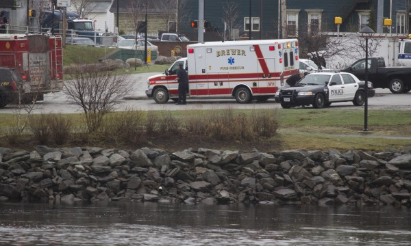 Rescue crews are parked on the Brewer side of the Penobscot River on Thursday afternoon after a woman, according to a witness account, jumped from the bridge and then swam to shore.