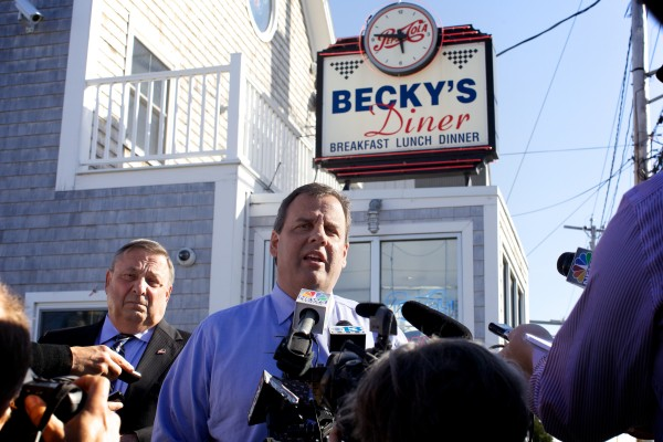 New Jersey Gov. Chris Christie talks to the press in front of Becky's Diner on Commercial Street in Portland with Maine Gov. Paul LePage on Wednesday. Christie is chairman of the Republican Governors Association and is in town for a pair of fundraisers.