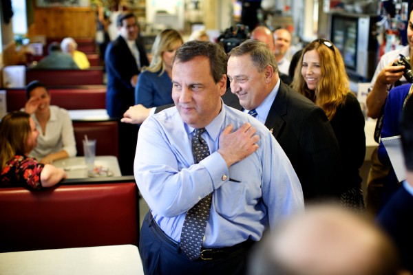 New Jersey Gov. Chris Christie walks through Becky's Diner on Commercial Street in Portland with Maine Gov. Paul LePage on Wednesday. Christie is chairman of the Republican Governors Association and is in town for a pair of fundraisers.