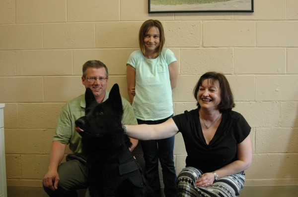 Samantha Quesnel, center, poses with her father John, her mother Bonnie and Dozer, the police dog with the Penobscot County Sheriff's Office who received a ballistic bulletproof vest, thanks to fundraising efforts by the Quesnels.